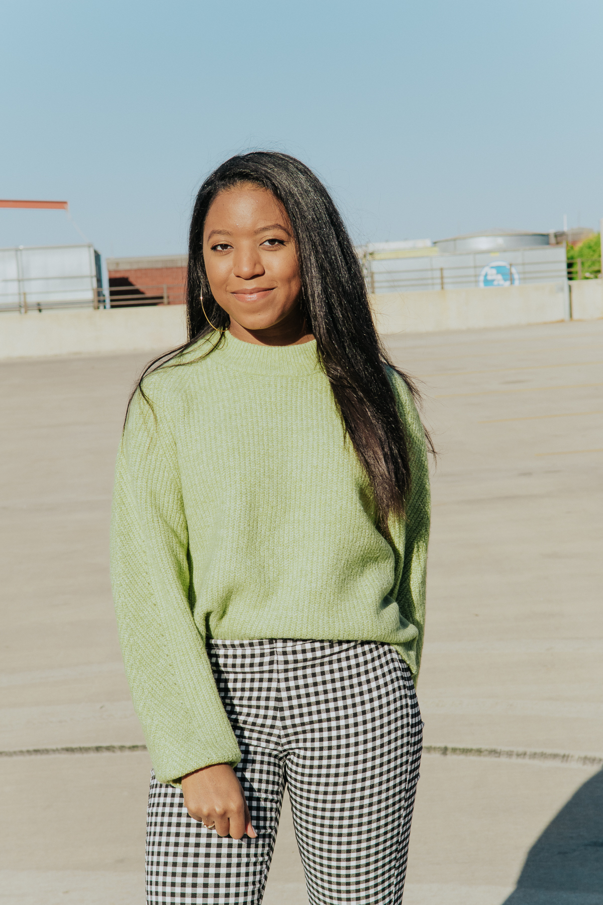 Styling a soft green sweater for a winter to spring fashion look